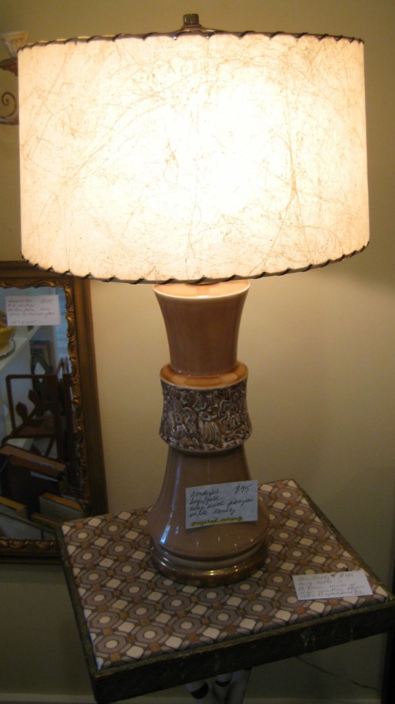 Terrific vintage lamp with fibreglass shade. Nice neutral colour for any decor. $95