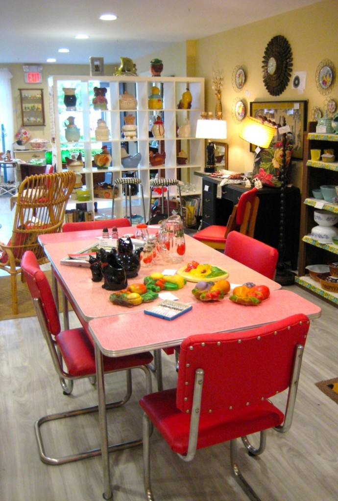 Red arborite table with gingham pastern top and two pop up end leaves.  Four matching chairs! $425