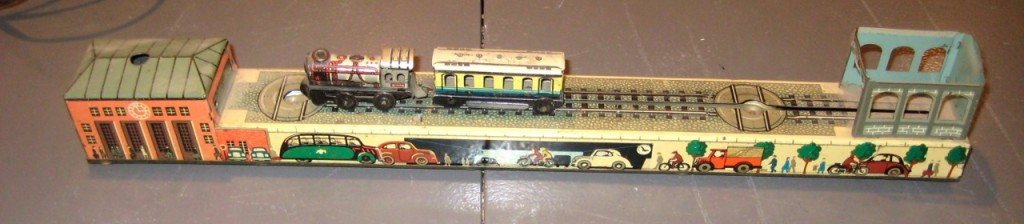 Vintage Arnold model train station. Includes both cars (one missing two wheels), wind-up key is also missing. Still in beautiful shape. 1940s $75