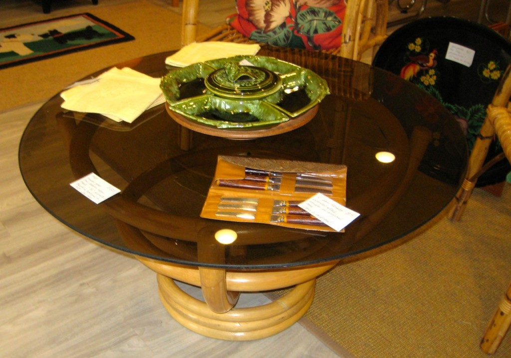 Rattan base and smoky glass-topped coffee table. 1070s $225