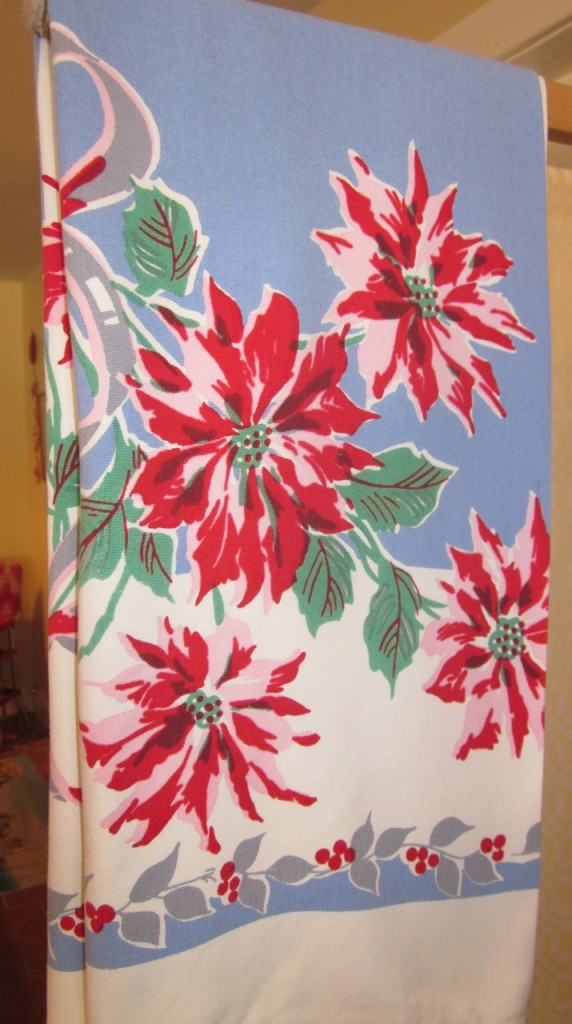 This rayon teacloth from the 1930s features beautiful bright clear colours ($30). 32 inch square.