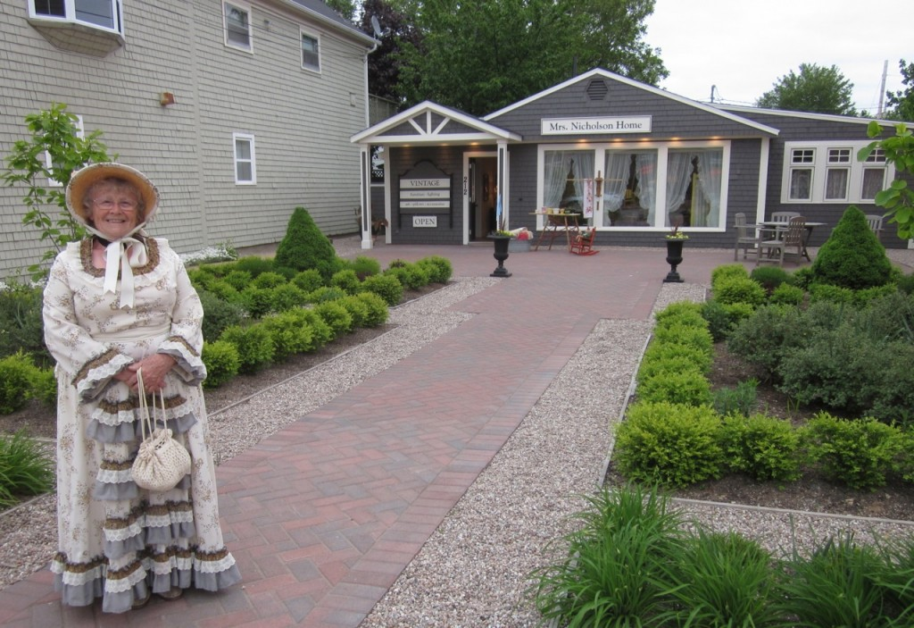 Val Davies, escort to the Town Crier, in front of Mrs. Nicholson Home last month