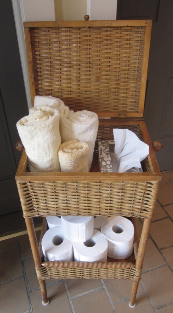 Vintage sewing basket transformed as a practical bathroom caddy ($175).