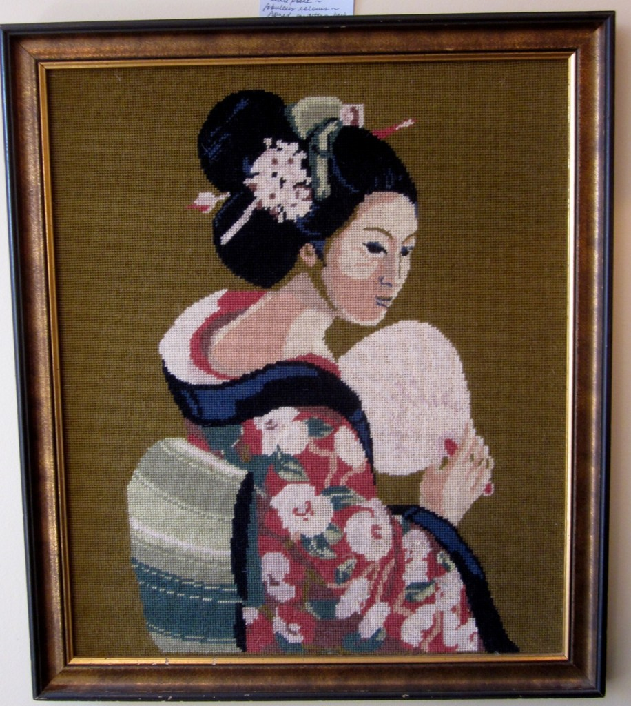 A vintage needlepoint of a Japanese lady ($95).