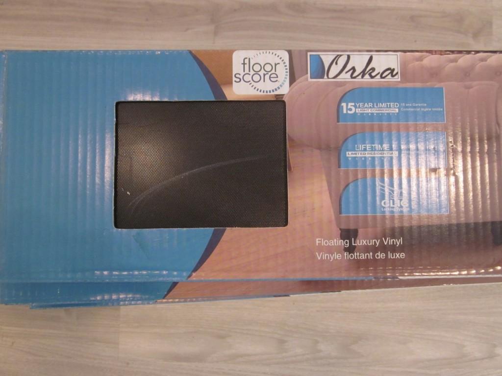 Orka vinyl plank in light grey.