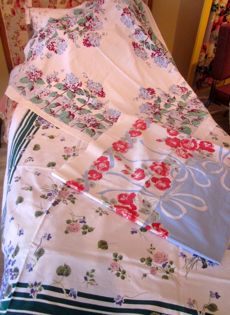 Lovely vintage tablecloths. A few tiny holes. No stains. Terrific for picnics. $20 each.