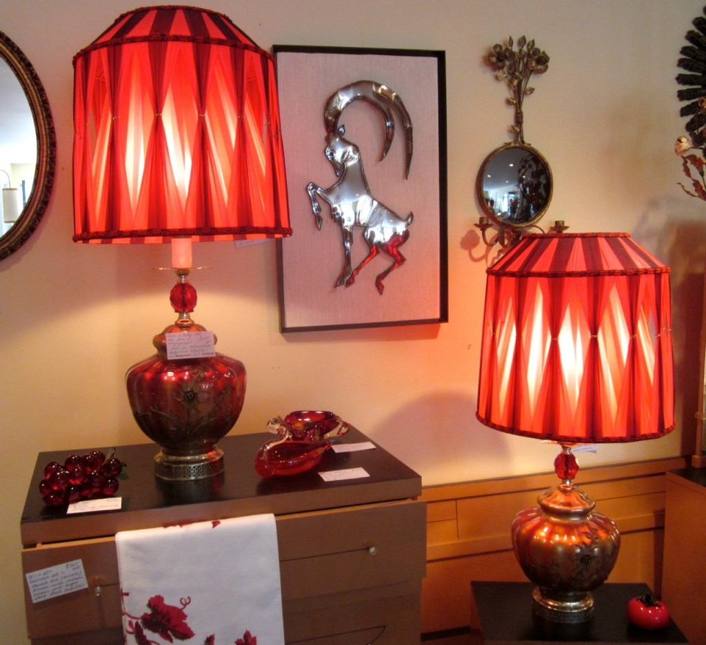 Pair of glam red glass lamps with metal overlay. Original ribbon shades. Original wiring. $125/pair