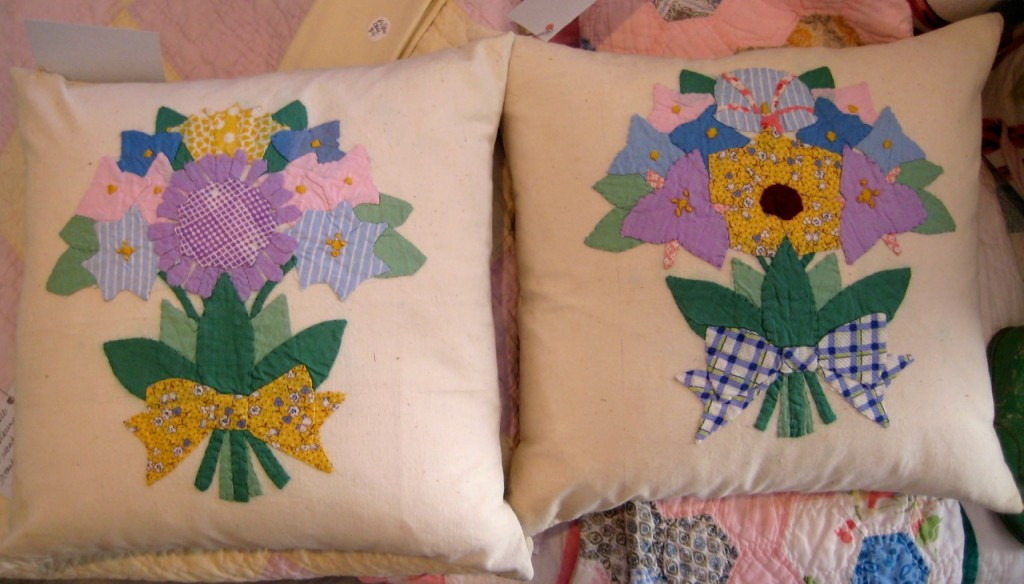 Pair of vintage appliqued flower bouquets. New inserts and  new striped cotton backing fabric $85 for the pair.
