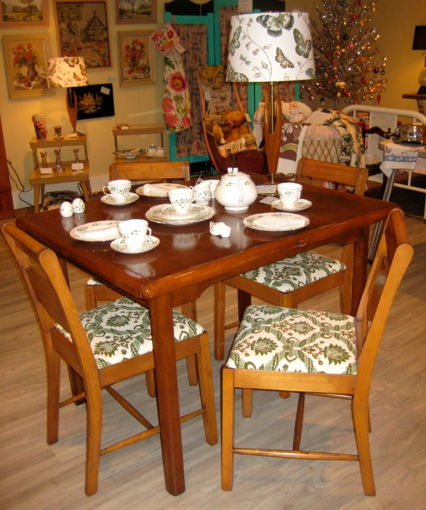 The complete hardwood dining set. 4 chairs with linen seat covers and the table. $425