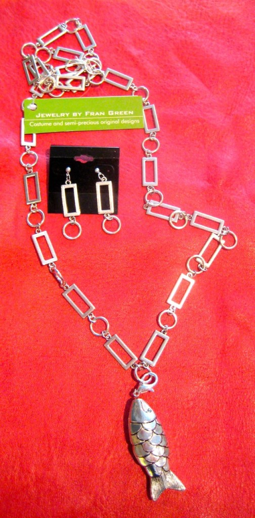 Silve-plated rectangle and circle link chain. ($95) Can be worn long or short with or without the fish pendant. Matching earrings ($35)