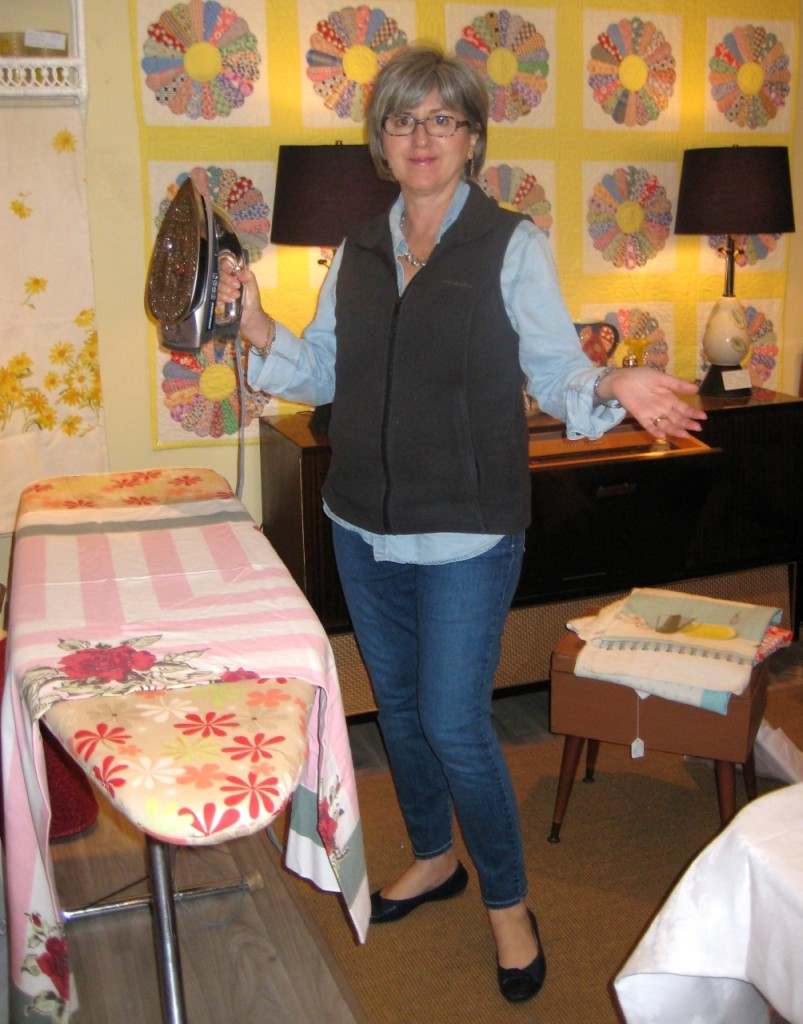 Jane busy ironing up the vintage textiles.