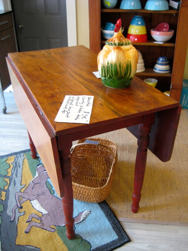 Drop-leaf table viewed from the side. $345