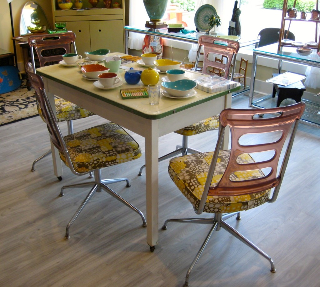 Amazing Lucite and chrome chairs! Perfect condition $345 for the set of four. Enamel baking table $195.
