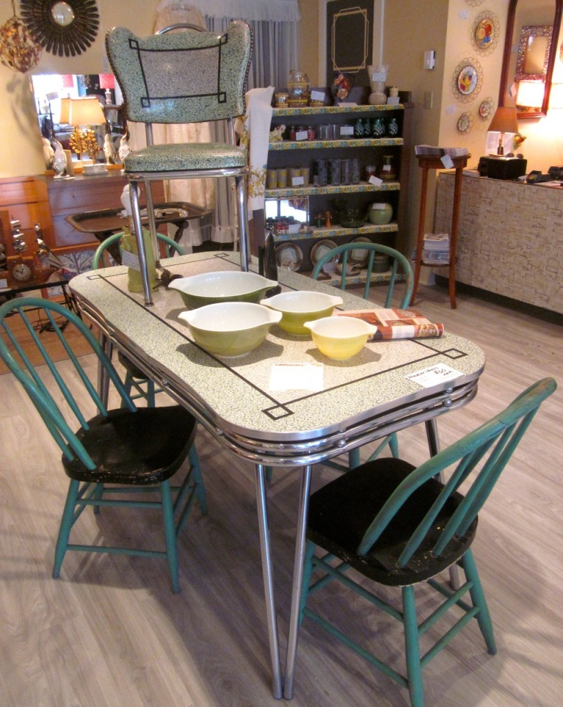 An outstanding chrome table.  Beautiful shape and colour. It comes with four chairs.  One is great condition, one faded and two with tears.  Really gorgeous! $475 set.