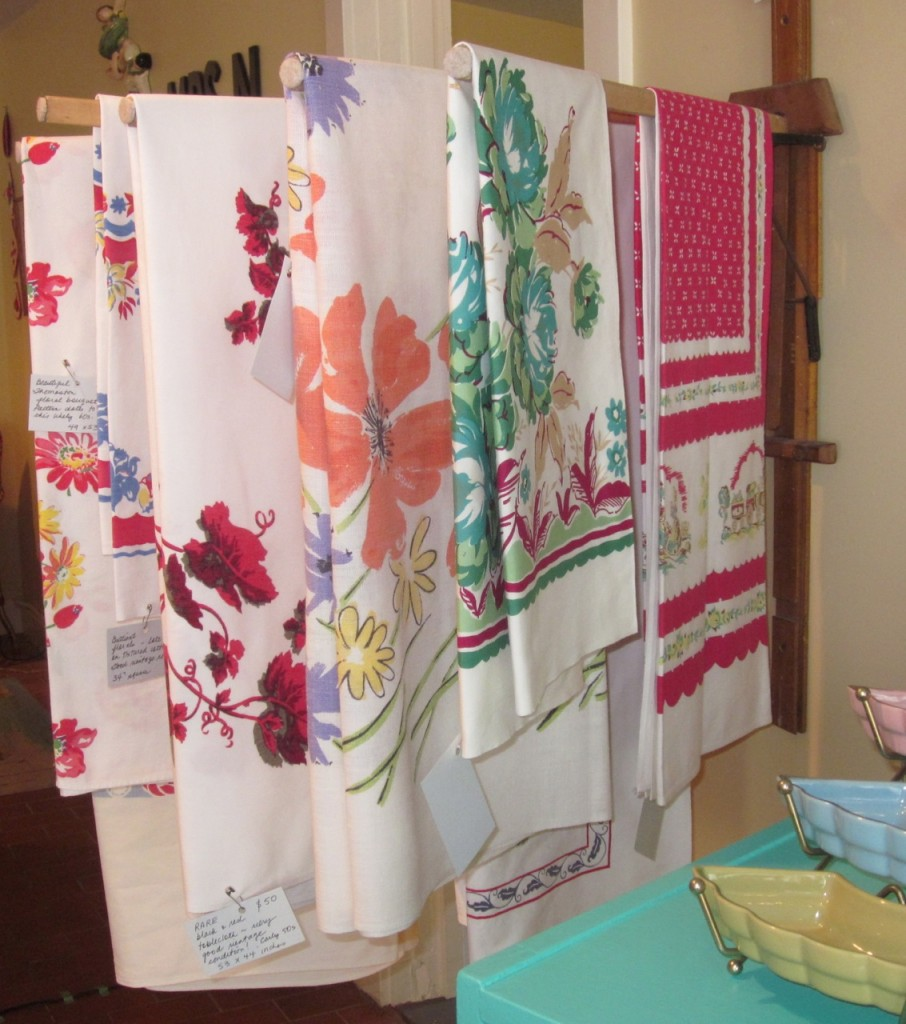 Selection of vintage tablecloths ($20 - $90).