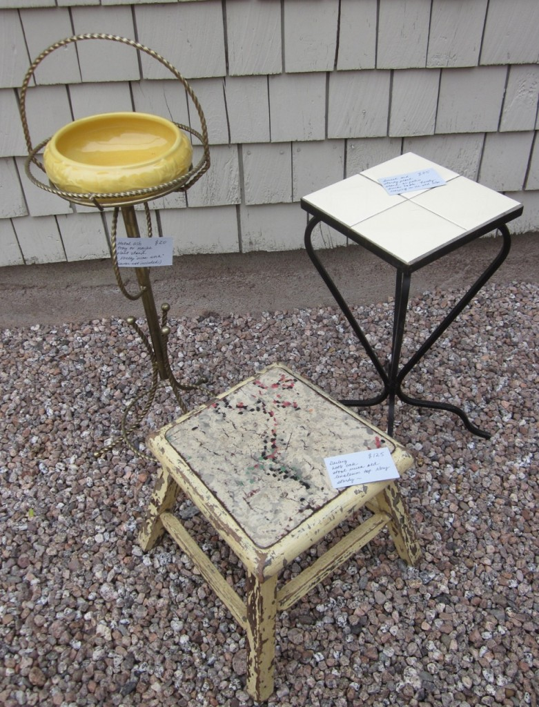 Metal plant stand ($20), yellow Shawnee bulb planter ($30), yellow-tiled table ($85)  and linoleum-topped oak stool($125).