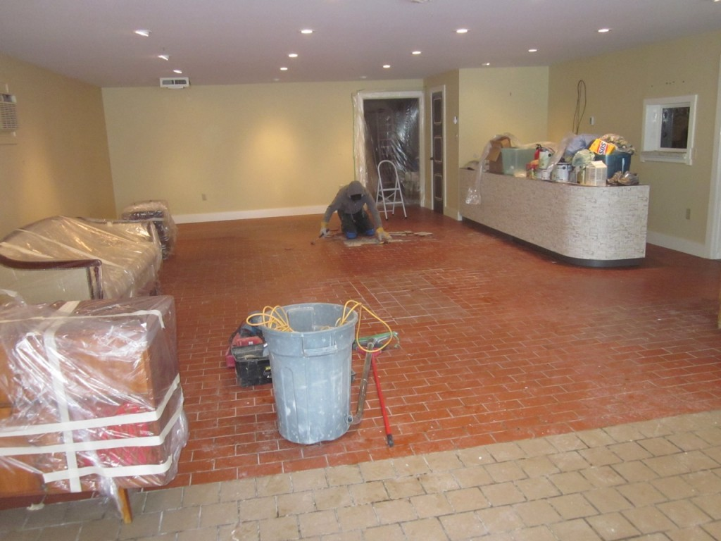 And the work begins by taking up the old tile. By hand and with the jackhammer!
