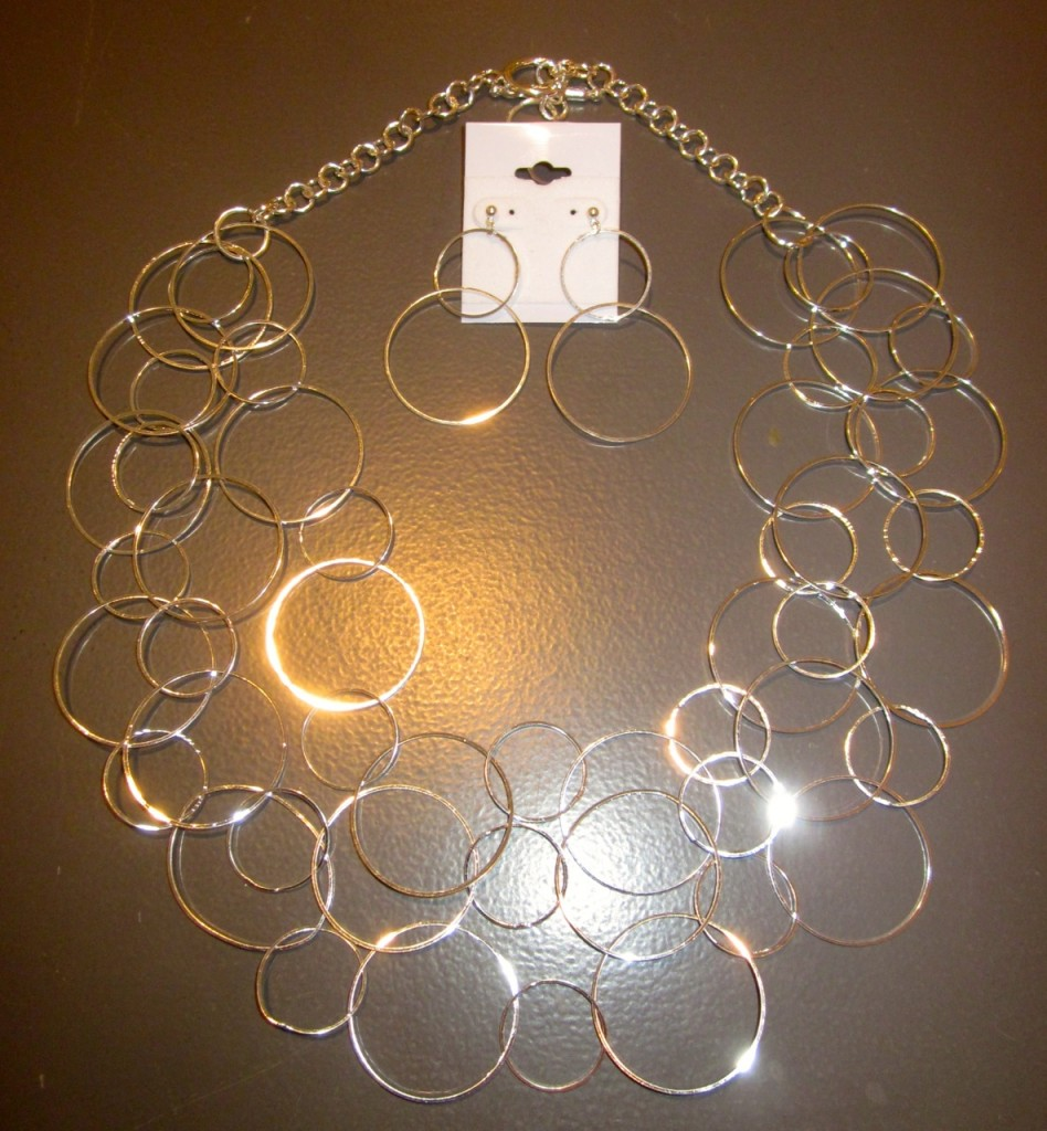 Triple strand silver-plated delicate large and small link necklace. $80 Matching earrings $25
