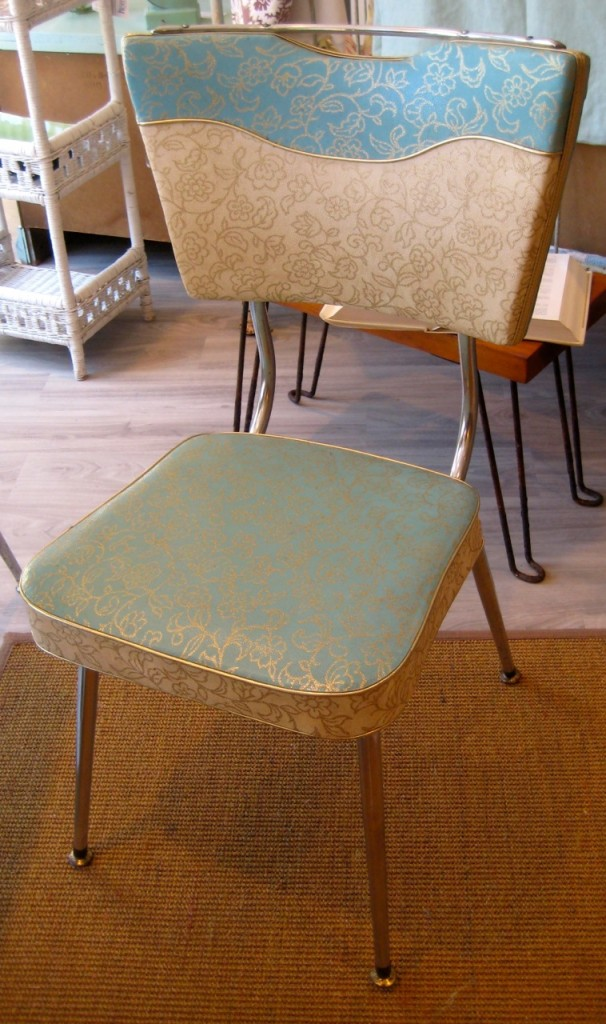 One of the four turquoise chrome chairs. Wonderful shape!