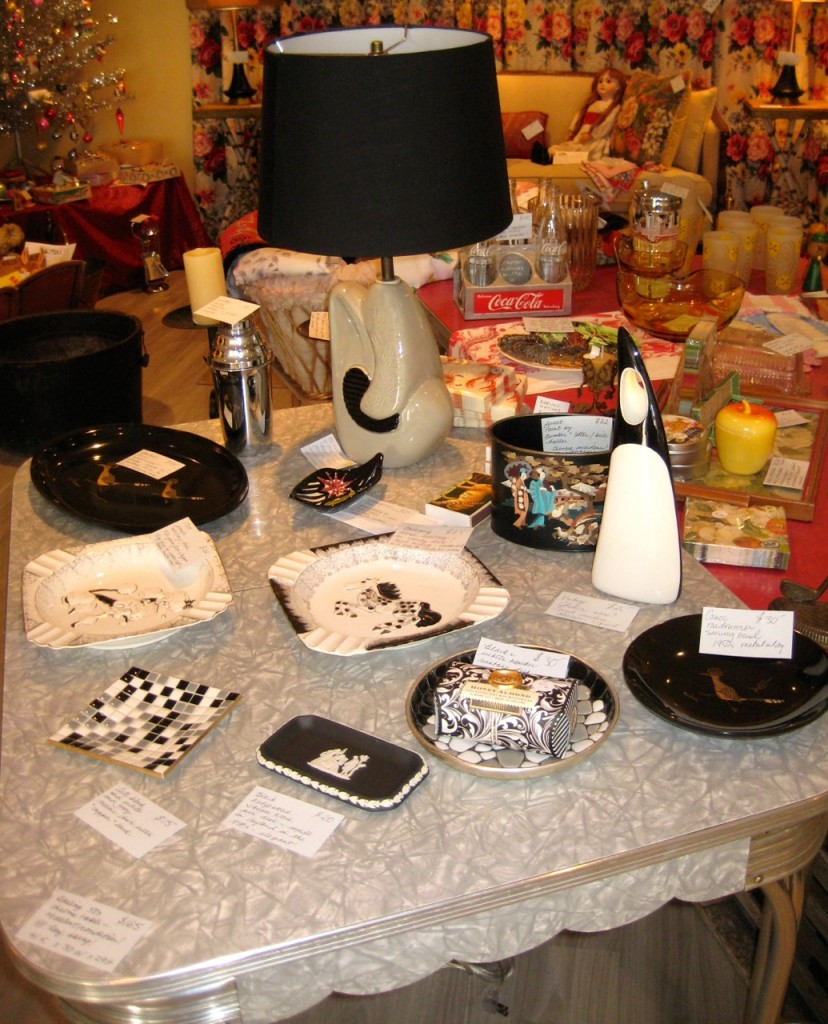 Black and white accent pieces! Couroc trays, an Italian vase, a mosaic pin tray, poodle and horsey ashtrays and a fabulous pair of black and grey amoeba lamps.