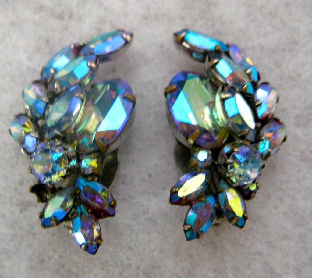 Sparkly Sherman clip on earrings. Stamped Sherman. Blue aurora borealis. $55