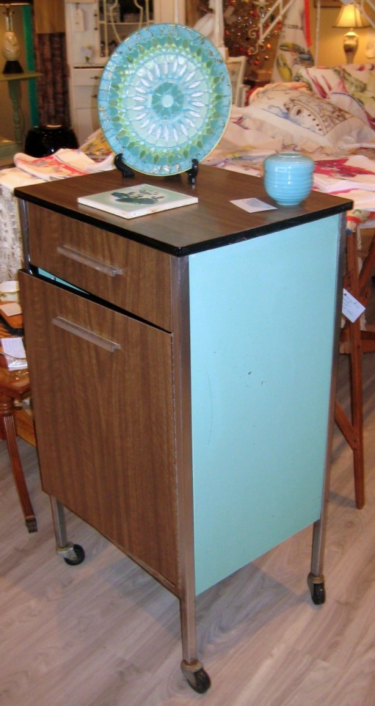 Rolling medical cabinet with formica top and front and turquoise metal sides and back. $225